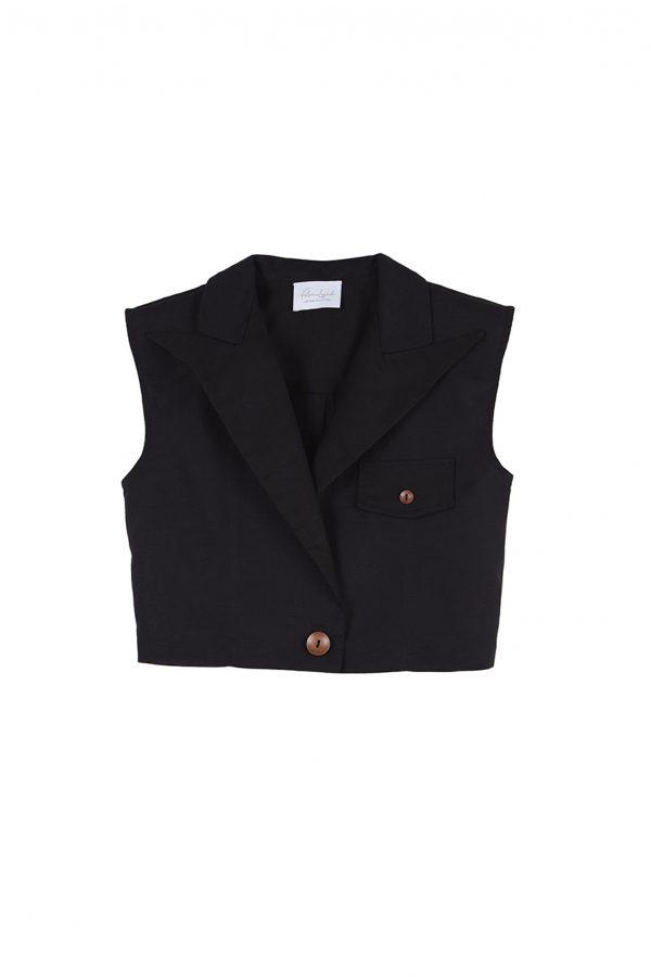 Chaleco corto de lino negro, con hombreras, detalle de pinza en la espalda, botones de madera y un largo ideal para usar con pantalones de cintura alta.